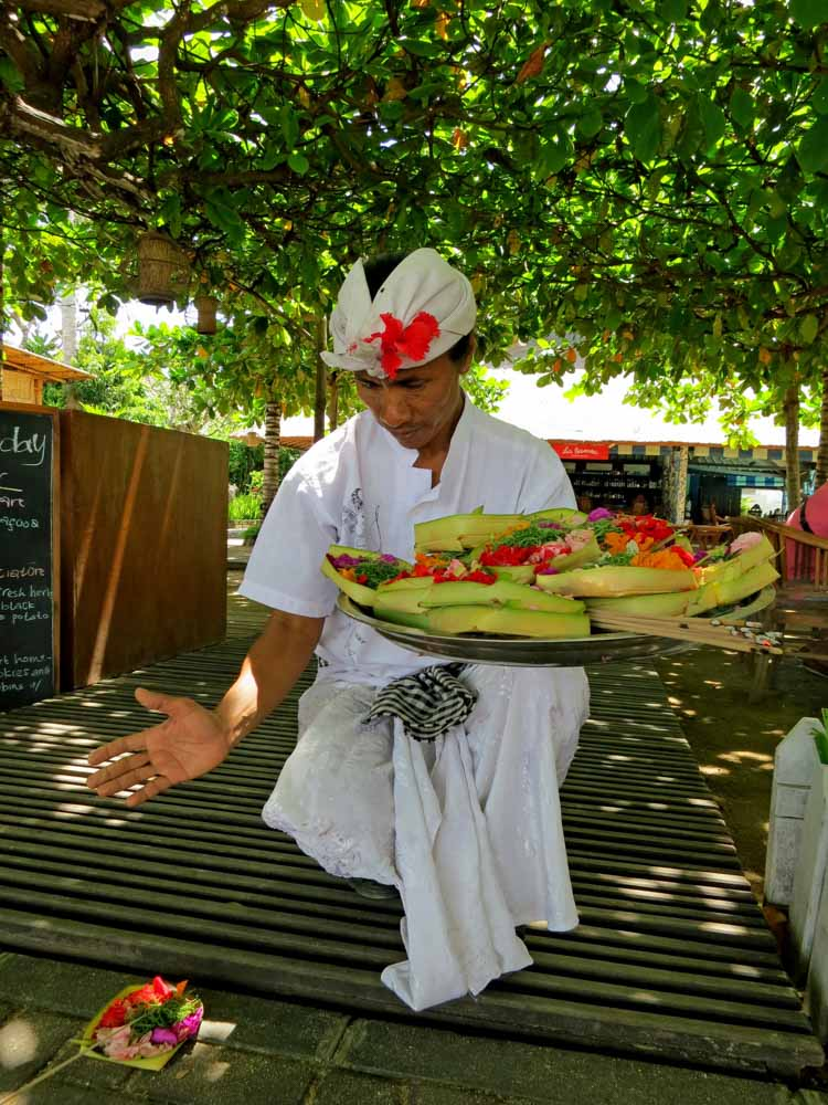 Man in white holding white plastic tray with fruits-what is culinary tourism