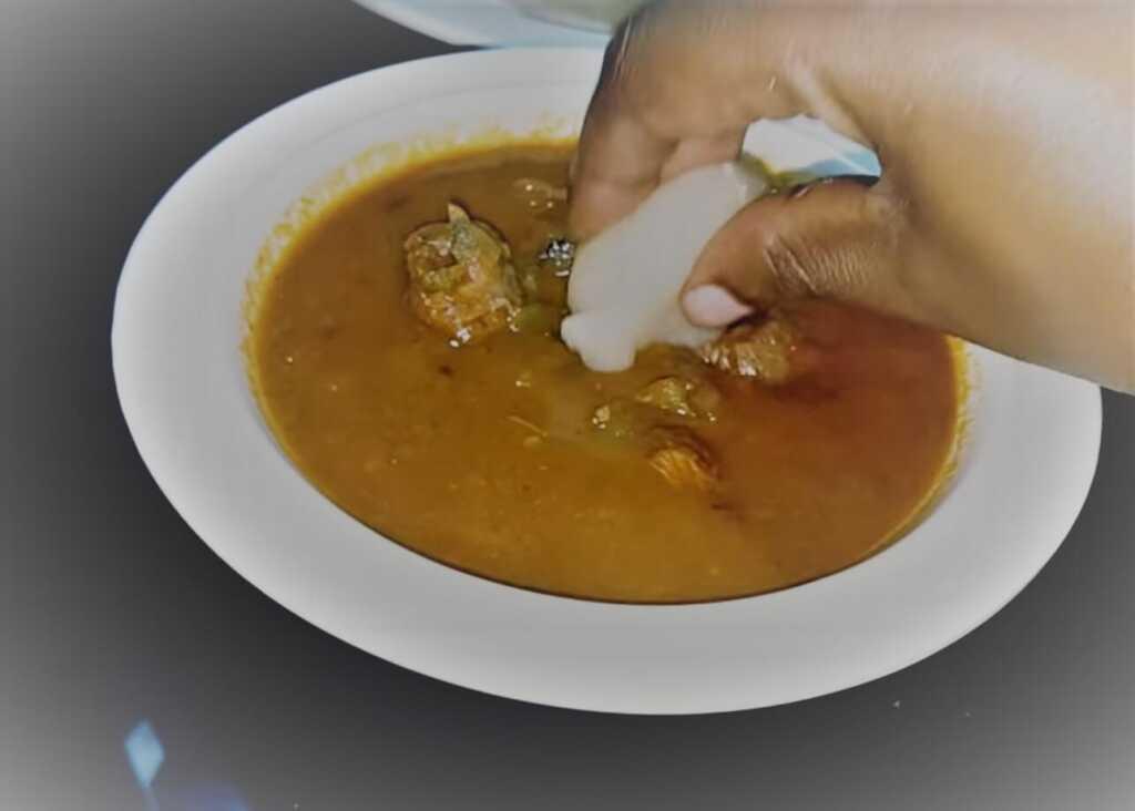 eating ugali with dishes-food in rwanda